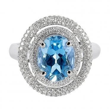 18ct White Gold Oval Blue Topaz and Diamond Surround Ring